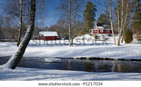 Winter landscape with Swedish cottage