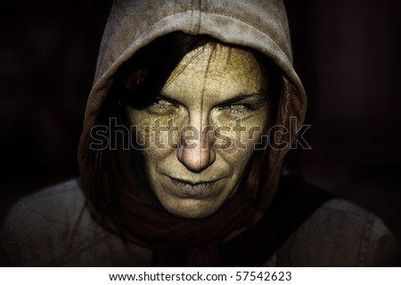 Witch portrait with the hood and black background