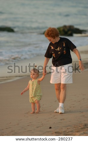 """Woman and a young girl walking on the beach, Hawaii, (Keith Levit)"""