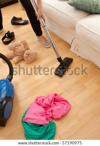 woman cleaning the living-room with a vacuum cleaner