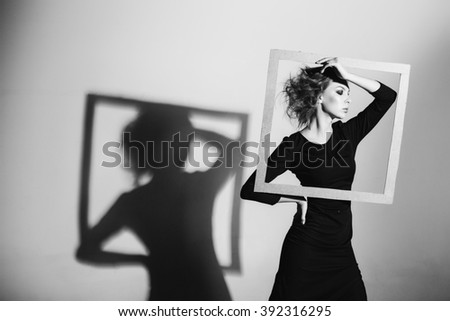 woman frame in his hands, fashion pose, black and white photo, studio shooting negativity, loneliness, divorce, pain, depression