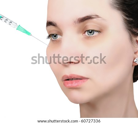 Woman getting cosmetic  injection, or  Hyaluronic acid and vitamins.