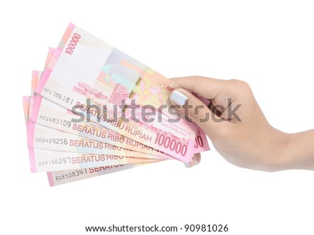 woman hand carrying money Indonesia, isolated on white background - stock photo