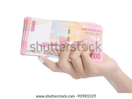 woman hand holding money Indonesia, isolated on white background