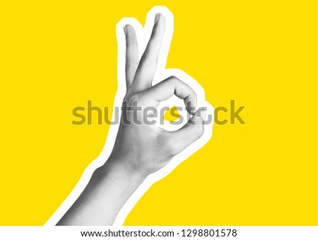 .Woman hand making sign. Isolated on yellow background .Hand symbol with yellow  backgroundhand pointing up middle finger, concept of rude hand sign or hand gesture, .Magazine style collage wit. #1298801578