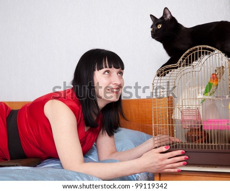 woman in red with  pets in home