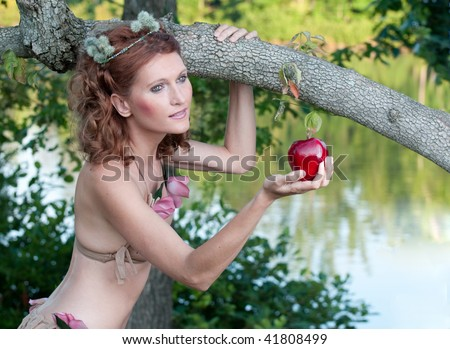Woman offering a red apple
