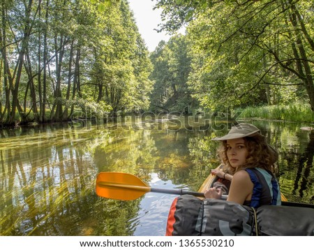 Woman on the kayak,  during canoeing  excursion on the Wda river. Bory Tucholskie. Poland, Europe