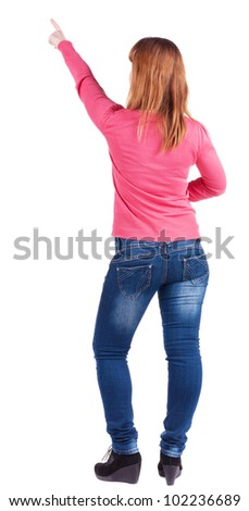 woman pointing. Back view . beautiful blonde  girl in jeans.  Rear view people collection.  backside view of person.  Isolated over white background.