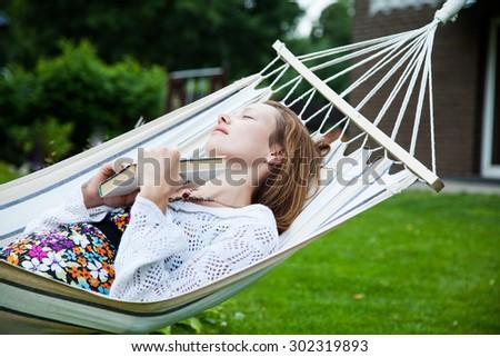 Woman relaxing in hammock #302319893
