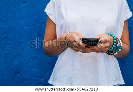 woman using mobile phone #554629213