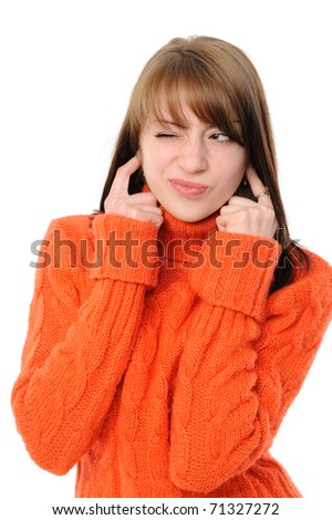woman with fingers in ears isolated on a white background - stock photo