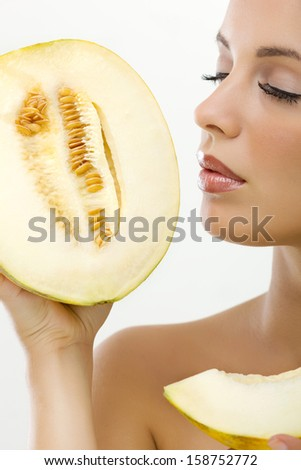 woman with perfect skin holding melons