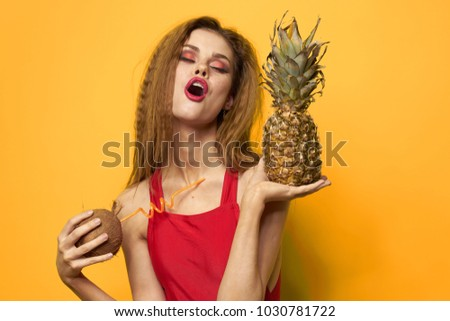 woman with pineapple on a yellow background, suntan, summer, exotic, coconut                              #1030781722