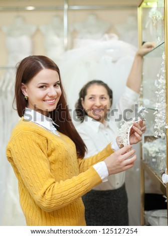 women  chooses bridal accessories in  boutique