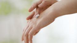 Women's hands with hand cream
