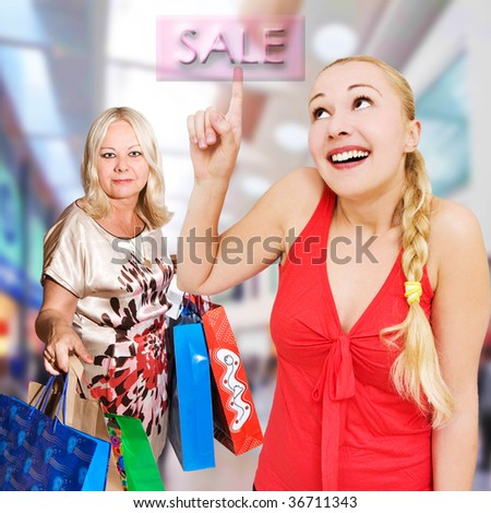 women shopping - 50 and 25 years old