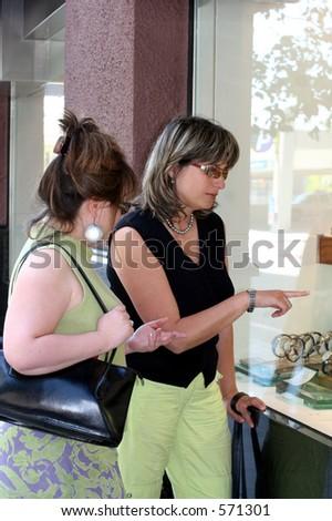 2 women window shopping