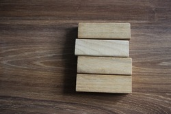 4 Wood Blocks Front View, On Wooden Table, polished wooden table background.
