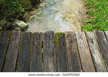 Wood bridge countryside with river.