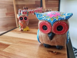 Wood carving with owl crafts And decorated with beautiful colors, including black, red, blue, white, looks cute