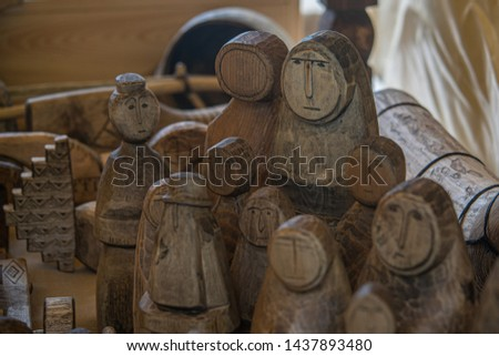 wood figurines. human, exhibition, wood carving. The faces of people carved from wood. wooden crafts