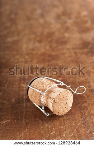 Wooden Background.Cork-stopper of champagne