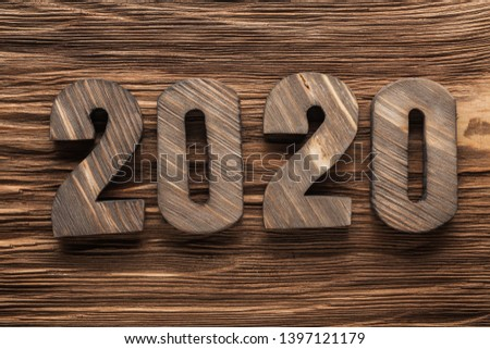 2020 wooden letters on vintage wood background