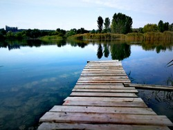 Wooden pier on a lake or river shore