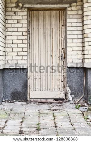 wooden plank doors, tiled ground