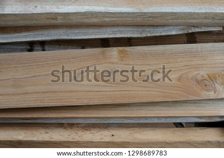 wooden sheets overlapping  prepare to be clear #1298689783
