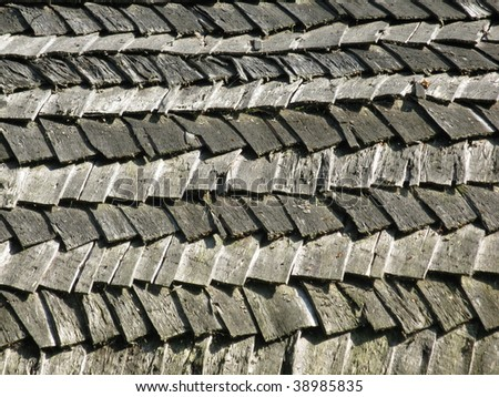 Wooden shingle roof as a background pattern