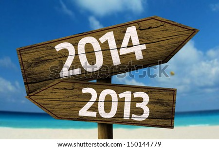 2013 2014 wooden sign with a beach on background