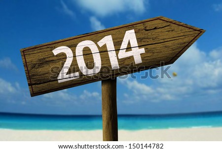 2014 wooden sign with a beach on background
