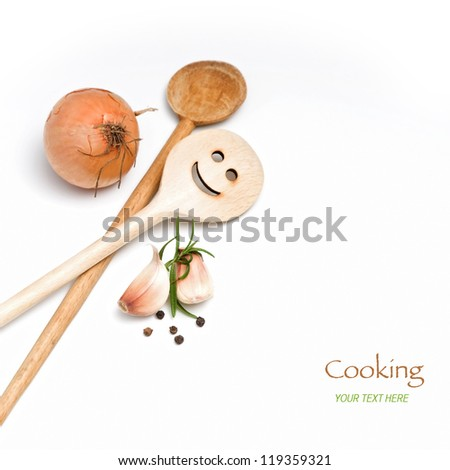 Wooden spoon with onion, garlic and spice