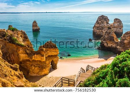200 wooden stairs leading to Praia do Camilo, Algarve, Portugal #756182530