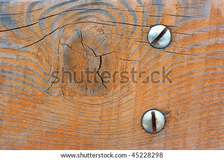 wooden surface with two bolts