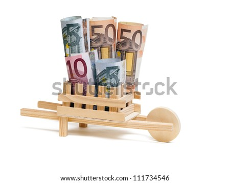 Wooden wheelbarrow with bills, isolated on the white background