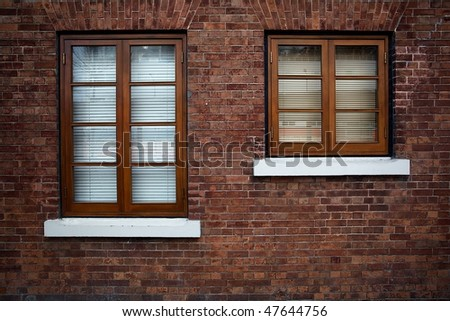 Wooden Window Shutter with brick wall