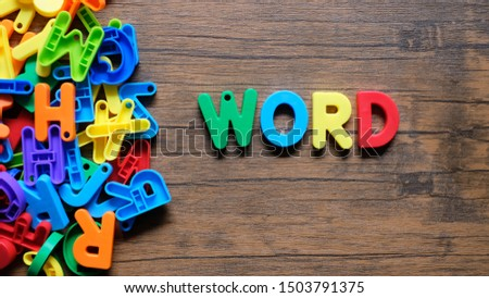 'Word' Colorful word on the wooden background #1503791375