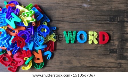 'Word' colorful word on the wooden background #1510567067