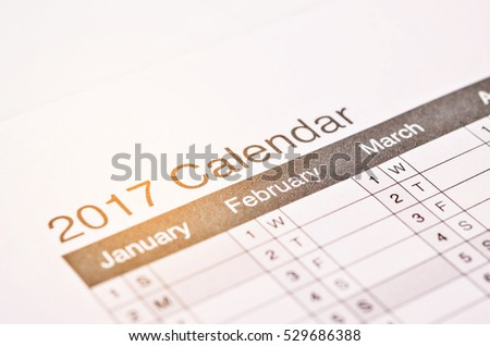 2017 wording on 2017 calendar desktop, Happy new year 2017 for fill text in space, background for new year Festival. #529686388