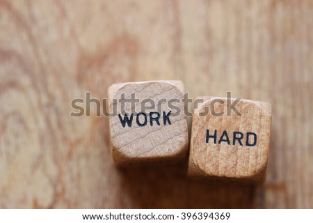 """Work hard"" printed on two wood dice against wood background open for copy #396394369"