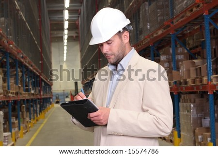 worker counting stocks and making notes