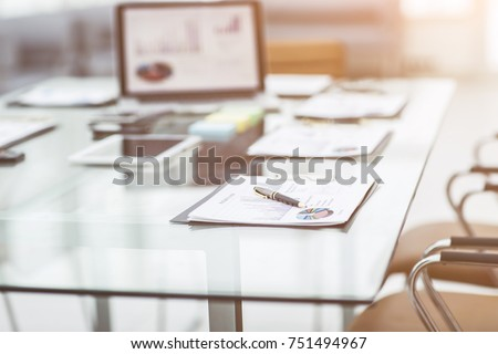 workplace with laptop and working documents for the business team in a modern office