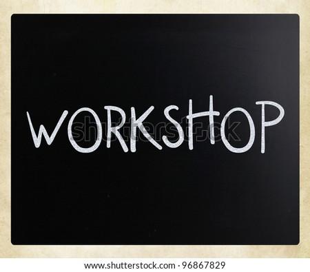 """Workshop"" handwritten with white chalk on a blackboard - stock photo"