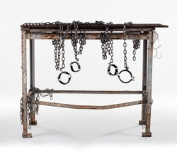 Workshop table isolated on white background. The workbench table is decorated with iron chains.