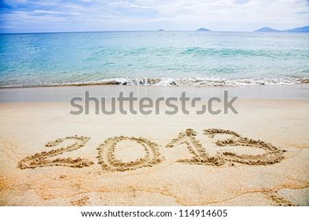 2013 written in sand on beach