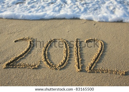 2012 written in the sand - stock photo