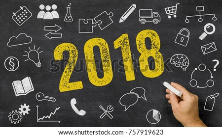 2018 written on a blackboard with icons  #757919623